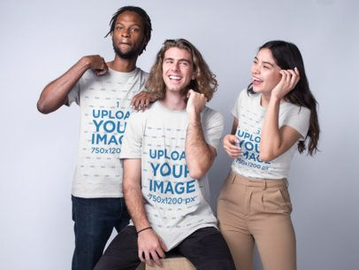 Interracial Group Featuring a Man with a White Guy and an Asian Girl Wearing T-Shirts Mockup a19952