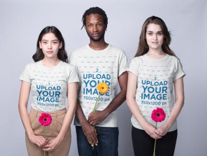 Mockup of Three Interracial Teens Wearing Shirts Mockup Holding Flowers a19918
