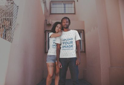 Young Couple Wearing T-Shirts Mockup Outside Their Apartment a20099