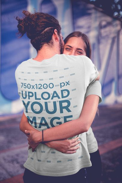 Long-Haired Man Wearing a T-Shirt Mockup Hugging his Girlfriend a20581
