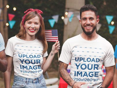 Woman and a Tattooed Man Wearing a T-Shirt Mockup at a 4th of July BBQ Party a20839