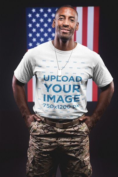 Smiling Veteran Wearing a Round Neck T-Shirt Mockup Against an American Flag a20929