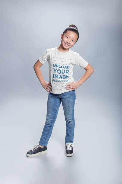 Mockup of a Happy Asian Child Wearing a Round Neck Tee Posing at a Photo Studio a20945