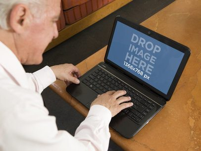 Elderly Man With HP Laptop at Home