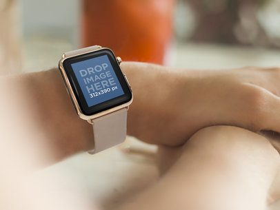 Woman Wearing a Gold and Beige Apple Watch at a Restaurant Mockup