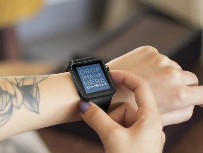 Young Tattooed Woman Using her Black Apple Watch Stock Photo Template