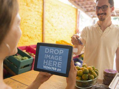 Mockup Template of Young Woman Using iPad at Small Market