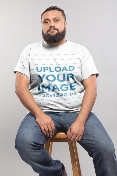 Plus Size T-Shirt Mockup Featuring a Man with a Beard Sitting on a Stool 20795