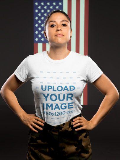 T-Shirt Mockup of a Woman Veteran Standing Against an American Flag 21215