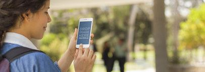 Mockup Template of Young Girl Using White iPhone 6 at School