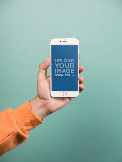 Mockup of a Hand Holding a Silver iPhone 8 Plus over a Solid Teal Background 21771