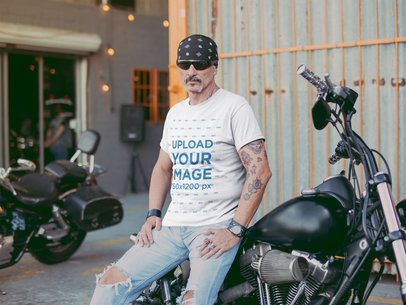 T Shirt Mockup Featuring a Tattooed Middle Aged Biker Leaning on a Motorcycle Outside a Bar 20242