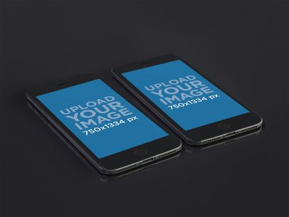 Mockup of Two iPhones 8 Floating Over a Dark Surface 22276