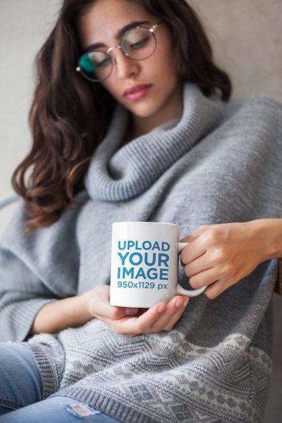 Mockup of a Girl Wearing a Winter Sweater Holding a Coffee Mug 22431