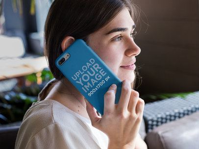 Mockup of a Girl Holding an iPhone Case Against Her Ear 22879