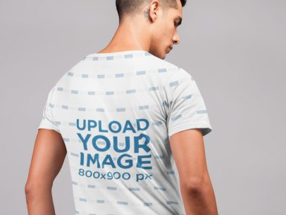 Mockup of a Man Wearing a T-Shirt in a Studio 21555