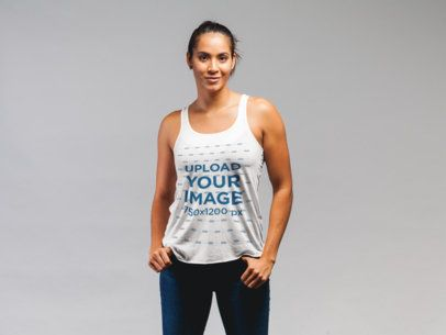 Tank Top Mockup Featuring a Fit Woman Posing Against a Flat Background 21581
