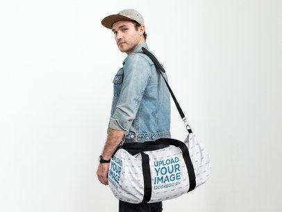 Duffle Bag Back View Mockup of a Man at a Studio 23054