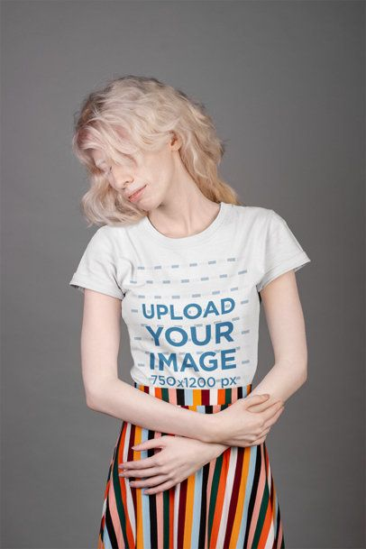 T-Shirt Mockup Featuring a Woman Wearing a Striped Skirt 21896