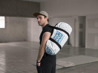 Mockup of a Kit Bag Hanging from a Man's Shoulder 23060