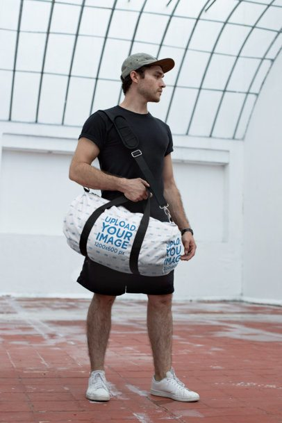 Mockup of a Sporty Man Holding a Duffle Bag 23061