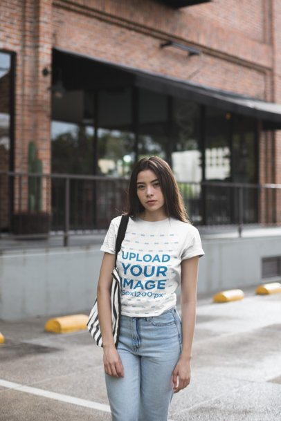 Unisex Tee Mockup of a Woman in Front of a Brick Building 23006