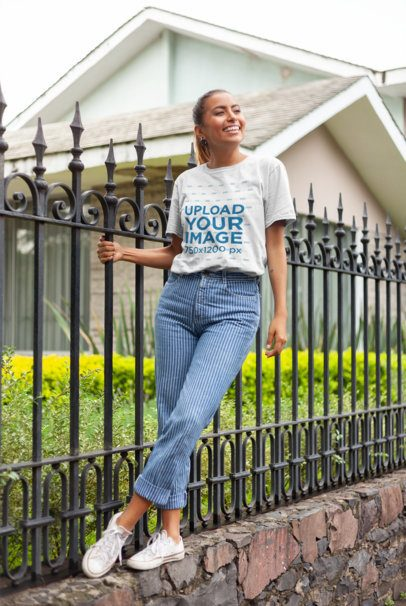 Mockup of a Happy Woman Balancing on a Ledge Wearing a Unisex T-Shirt 22797