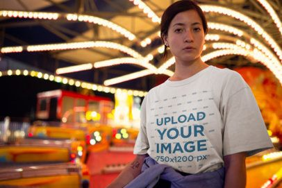 Unisex Tee Mockup Featuring a Serious Woman In Front of a Carnival Ride 22982
