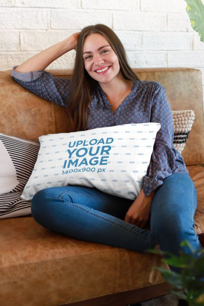 Pillow Mockup of a Woman Relaxing on a Leather Coach with a Pillow on Her Lap 23616