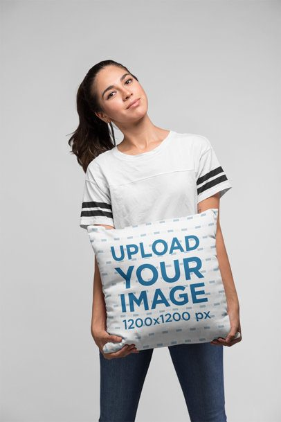 Mockup of a Woman Holding a Pillow Against a Flat Background 23675