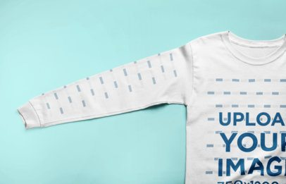 Long Sleeve T-Shirt Mockup Lying Flat on a Solid Color Surface 24210
