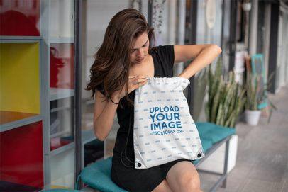 Drawstring Bag Mockup of a Gorgeous Girl Looking Through Her Bag 23666