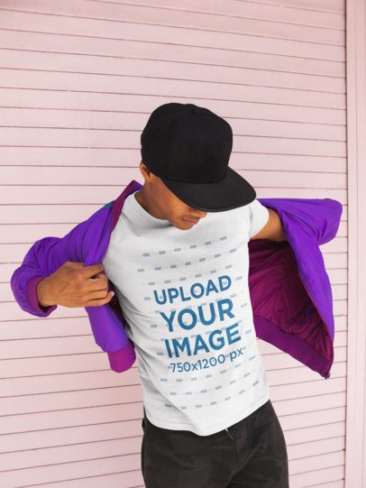 T-Shirt Mockup of a Cool Man Trying out a Retro Jacket 21064