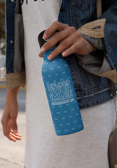 Mockup of an Aluminium Bottle Held by a Woman 24419