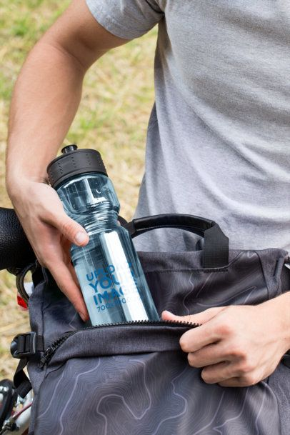 Mockup of a Man Putting Away His Sports Bottle 24429