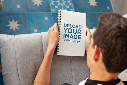 Mockup of a Boy Looking at His School's Notebook 24138