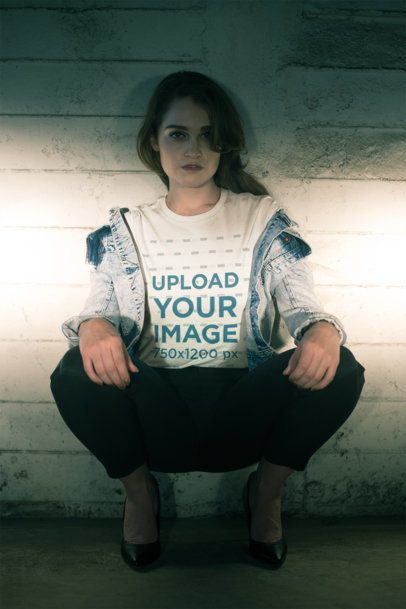 Tshirt Mockup of a Handsome Female Model Crouching at Night 20068