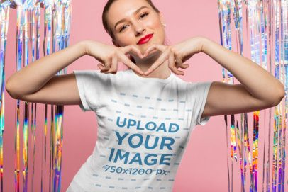 Valentine's Day T-Shirt Mockup of a Girl Making a Heart Sign with Her Hands 25423
