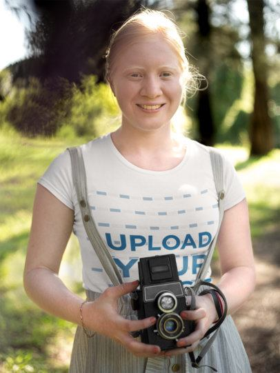 Mockup of a Woman Holding a Vintage Camera 22002