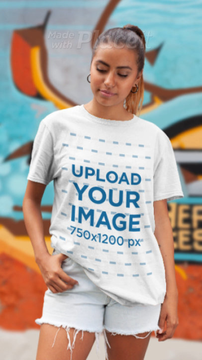 Parallax Video of a Woman with a T-Shirt Standing by a Graffiti Wall 25598