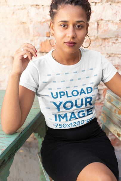 T-Shirt Mockup of a Beautiful Girl Sitting on a Rustic Wooden Chair 24085