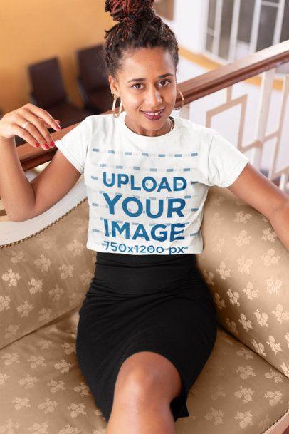 Tshirt Mockup of a Woman Sitting on a Vintage Sofa 24083