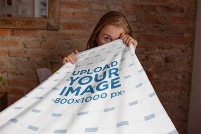 Mockup of a Woman Covering Her Face with a Blanket 24676
