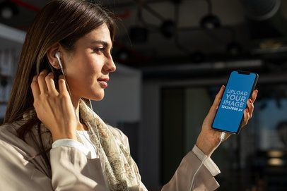 iPhone XS Max Mockup Featuring a Young Woman Listening to a Podcast 24788