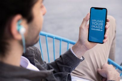 iPhone Mockup of a Man Listening to a Podcast with His iPhone XS Max 24814
