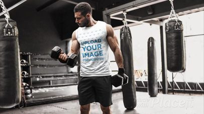 Parallax Video of a Muscled Man Lifting Weights at a Boxing Gym 26346