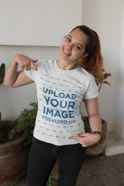 Mockup of a Happy Customer Showing off Her T-Shirt 26191