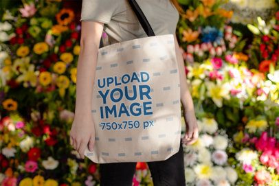 Tote Bag Mockup of a Woman Surrounded by Flowers 24874