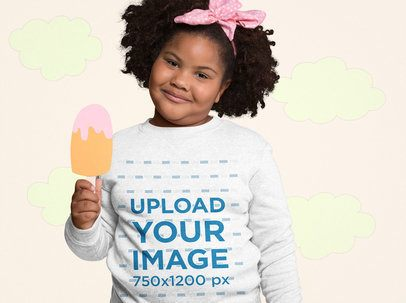 Mockup of an Afro-Haired Girl Wearing a Plus Size Sweatshirt Holding a Cartoon Popsicle 25575