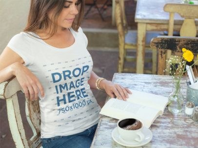 T-Shirt Mockup of a Woman at a Cafe Reading a Book 7724